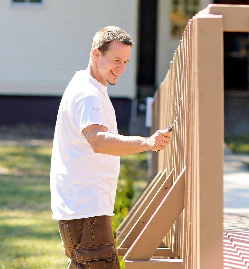 Man Wearing White Shirt Painting Fence - Enrichment