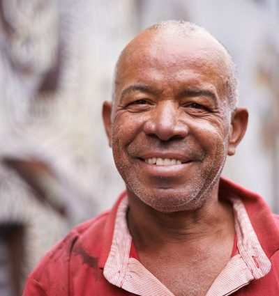 Portrait of Man in Red Shirt Smiling
